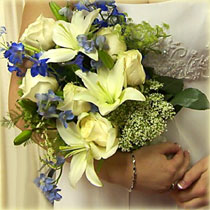 Hand held wedding bouquet with lilies, delphinium & queen annes lace for a garden look